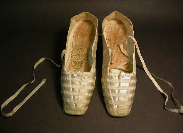 Pair of white satin shoes worn by Queen Victoria on her wedding day | Image via Wikipedia